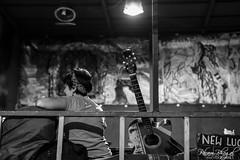 Girl and the Guitar (DSF_9583) (Param-Roving-Photog) Tags: patron customer guest girl female woman subject back guitar musical instrument equipment cafe restaurtant coffee talk conversation people rishikesh lakshmanjhula uttarakhand streetphotography nikon nikkor monochrome blackandwhite bw