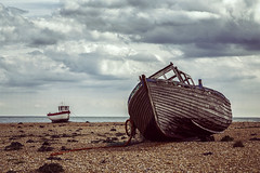 Dungeness Boats (JennTurner) Tags: dungeness kent coastal seaside beach boats fishing rotting erosion bleak pebbles perspective