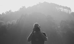 3050 (saul gm) Tags: man camera cámara hombre bold shooting photographer photo metaphoto mountain outdoors montaña trees bn bw blackandwhite blancoynegro asturias asturies españa spain spanish light naturallight nature portrait contrejour backlit backlight contraluz waistup front