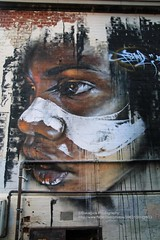 Adelaide, painting on the facade of a house (blauepics) Tags: australia australien south südaustralien adelaide city stadt building gebäude house haus wall mauer facade fassade graffiti painting gemälde art kunst face gesicht aborigines ureinwohner