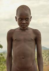 Natural, Mursi Boy (Rod Waddington) Tags: africa african afrique afrika äthiopien ethiopia ethiopian ethnic etiopia ethnicity ethiopie etiopian omo omovalley outdoor portrait boy child cultural culture natural mursi tribe traditional tribal mago