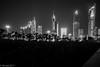 Sharq area night skyline... (EHA73) Tags: summiluxm11424asph leica leicamm typ246 blackandwhite bw kuwait kuwaitcity sharq skyline cityscape alshaheedpark park plams palmtrees nightphotography towers buildings skyscrapers alhamratower