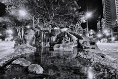 FISHERMAN IN DOWNTOWN (Brandon Kapana Photography) Tags: downtown honolulu hawaii aloha canon canon80d water structures handmade love fisherman nets stone photography waterfall silky wide wideangle night nightlife longexposure