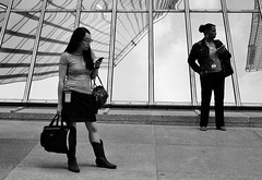 Bus Stop Cowgirl (burnt dirt) Tags: houston texas downtown city town mainstreet street sidewalk corner crosswalk streetphotography fujifilm xt1 bw blackandwhite monochrome purse bag cellphone phone girl woman people person asian metro bus busstop cowboyboots boots pair couple standing waiting longhair glasses