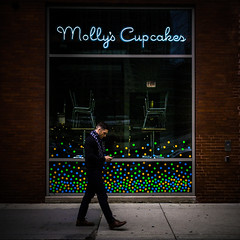Molly's (Darren LoPrinzi) Tags: 5d canon5d chicago canon chitown miii street streetphotography square squareformat low key dark man walking phone store storefront city urban rivernorth