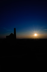 The Stack and the Sunset (richardsolway) Tags: mining wheal peevor cornwall redruth sunset sun set landscape enginehouse old shadows dark flare
