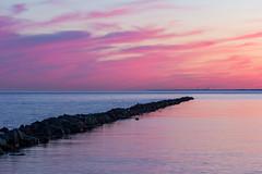 Breakwall (Nicoli OZ Mathews) Tags: sunset beautiful toronto torontoislands red clouds landscape lake lakeontario light water island centreisland beach sky pink canada foreground shadow