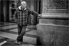 Hold Up, Wait a Minute (Steve Lundqvist) Tags: elderly aged age people vecchio vecchiaia teramo italy italia italiano povertà poverty bw blackandwhite monochrome street fujifilm x100s streetphotography candid shot snap eyecontact