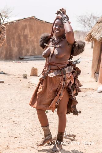 Himba woman near Opuwo checks her hair