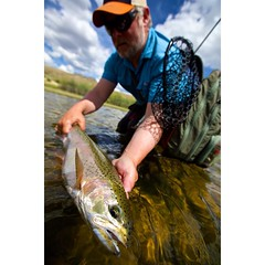@parkcityflyfishingguides and @northplattelodge guide Erik Hufnagle releasing a hefty rainbow that clobbered an @solitudeflyco #articulatedgoldie @scottflyrods @airflousa @simmsfishing #northplatteriver #flyfishing #fishwyoming