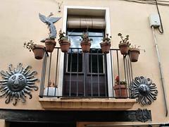 213 Spanish Balcony (saxonfenken) Tags: 1055s 1055 balcony ornaments pots railing