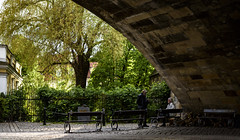 Conversation under the Charles Bridge (Prague) (Andreas Mezger - Art Photography) Tags: prag prage praha bridge street people dark wet foreign country traveling trees reflection light dusk twilight charles