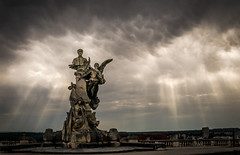 Public lights (Jean-Luc Peluchon) Tags: light impressive monument cloud sky weather thunderstorm ray sunbeam town dramatic lumix contrast storm atmosphere landscape