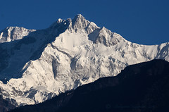 Mt. Kanchenjunga (8586 m) , the 3rd Highest peak in the world (Shakyasom Majumder) Tags: himalayas sikkimtourism westsikkim kanchenjunga kanchenjungarange mtkanchenjunga hills mountains mountainpeaks mountainrange day outdoor nature naturephotography naturalbeauty sky blue nikon nikond7000 afsnikkor300mmf4difed pelling northeastindia nopeople