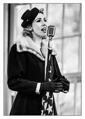 You must remember this (A.I.D.A.N.) Tags: blackwhite blackandwhite portrait woman singer portraits women singers 1940s forties fur nottingham nottinghamcastle 1940skneesup americanflag starsandstripes microphone historicalreenactment music tradition wartime wwii worldwartwo vintage female song singing 70200mmzoomlens light high key canon 5d mark ii canon5dmarkii eos daytime photoborder windows highkey highkeyportrait history