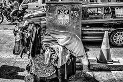 A Shopping Trolley He Calls Home.jpg (Pauls-Pictures) Tags: 35nmf14lens australia australian australianstreetphotographers compactcamera fxlens fuji fujifilm photography streetphotograhy sydney trollies xt1 achromatic alone belongings blackandwhite camera candid city homeless homelessness lens lonely mirrorlesscamera monochrome ownership people photographers poverty sad shopping standard streetphotographer streetphotos streetpics streetpictures trolley urban