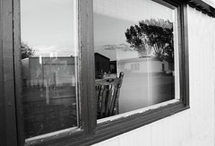 reflections (aspen marie florey) Tags: southdakota country lonely house digital emotion architecture building monochrome reflection window blackandwhite