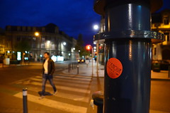 """The pursuit of happiness"" (Jean-Luc Léopoldi) Tags: nuit zebracrossing sticker autocollant humour soir evening passage passant pedestrian piétons rue street ville"