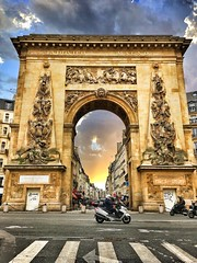 Paris  France ~  Porte Saint-Denis  ~ Historic Monument (Onasill ~ Bill Badzo) Tags: paris france porte saint denis historic monument tourist travel vacation parisian gates wall charles v walls city tur saintdennis boulevard onasill steet scene urban streetscape art arch attractionsite triumphal arches arc de triomphe du carrousel saintmartin motorcycle scooter phorgraphty iphone sky clouds