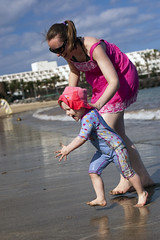 Laura and Emily running on the beach (dan.oxlade) Tags: d40 nikkor nikkor50mm118g beach child polarisingfilter nikon lanzarote spain holiday