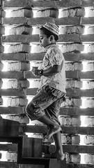 Kid on stairs 3125 3bw (shahidul001) Tags: mosque prayer religion spirituality islam baiturrouf agakhanaward architecture marinatabassum light design community