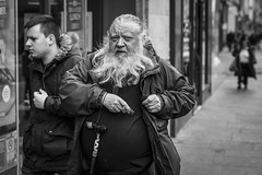 Middle-Earth (Leanne Boulton) Tags: monochrome people portrait urban street candid portraiture streetphotography candidstreetphotography candidportrait streetportrait streetlife eyecontact candideyecontact old man male face facial expression eyes beard look emotion feeling tone texture detail depthoffield bokeh naturallight outdoor light shade shadow city scene human life living humanity society culture canon canon5d 5dmarkiii 70mm ef2470mmf28liiusm character black white blackwhite bw mono blackandwhite glasgow scotland uk