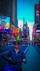 Amanda is all smiles while cycling near Times Square in NYC.