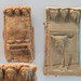 Locri, Grotta Caruso: miniature terracotta herms with offerings and Acheloos