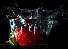 Splash of Strawberry (anjabrits) Tags: fruit splash water dark red strawberry drop food organic health natural refreshing wet liquid falling closeup nature eating fresh green texture anjabritsphotography hss flashphotography highspeedsync studio colorful