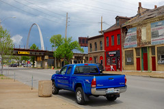 St. Louis, blues (and reds) (KevinIrvineChi) Tags: union pacific railway railroad tracks viaduct arch eero saarinen red blue truck toyota st louis missouri spring 2017 sony dscrx100 downtown gray clouds cloudy steel buildings outdoor outside jeans woman rooftops blues reds iron yellow signs urban consumerist nephews now leasing south 4th street gratiot fourth lasalle park grille 13 ft 6 fire hydrant sidewalk trash can garbage tacoma powerlines doors windows storefronts
