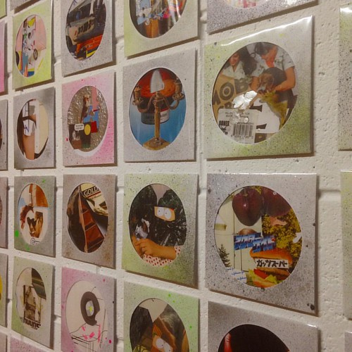 Wall of Torv Ogaswara collages at @privatedealr   . Spotto the doglet.