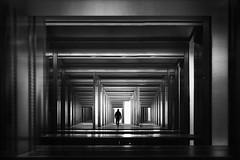 ...   labyrinth   ... (*ines_maria) Tags: monochrome mono bw blackandwhite urbanart urban run man person labyrinth light geometry city