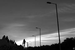 Leaving... (tzevang.com) Tags: greece bw silhouette pfaliro sky sunset