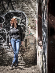 Hanneke, Amsterdam 2017: Graffiti babe (mdiepraam) Tags: hanneke amsterdam frankendael 2017 portrait dutch pretty attractive gorgeous beautiful elegant classy mature fiftysomething woman redhead curls naturalglamour lady girl milf jeans denim leatherjacket graffiti