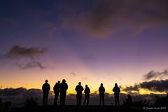 Watching the sunrise at Munro Hut (NettyA) Tags: 2017 3capestrack australia sonya7r tasmannationalpark tasmanpeninsula tasmania tassie threecapestrack bushwalking hike hiking sunrise munrohut day3 silhouette people crepuscularrays