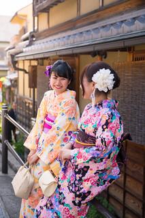 Japanese women in kimono talking in Kyoto traditional city