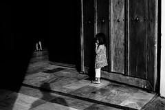 Leaning Against The Door (Meljoe San Diego) Tags: meljoesandiego fuji fujifilm x100f streetphotography candid people shadow monochrome philippines