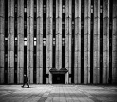 Deep in thought 2 (burnsmeisterj) Tags: olympus omd em1 building architecture man walking lines mono monochrome blackandwhite