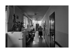 Corridor (Jan Dobrovsky) Tags: atmosphere blackandwhite contrast corridor document figure grain human indoor leicaq monochrome mood northernbohemia people reallife retirement