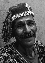 Portrait of a Sintir player in Monochrome, Jemaa El-Fna, Medina, Marrakech, Morocco (Cozy61) Tags: marrakech morocco travelphotography travel cobra snakes fujifilm xpro1 culture souk cafedespices justgoshoot snakecharmer photooftheday day1 x100 fujifilmxseries local koutoubiamosque place jemaaelfna el jadid medina market mosquée koutoubia music sintir traditional handmade musician nofilter instagood instatravel travelgram tourism instago passportready ilovetravel handheld slowshutter portrait monochrome draga blackandwhite dragan