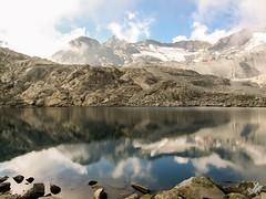 Lago del Monticello, Rifugio Capanna Presena e Ghiacciaio Presena (diegoavanzi) Tags: ghiacciaio presena glacier lago lake monticello tonale riflessi reflections trentino italia italy montagne mountain nuvole clouds