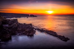 Sinking Fireball (Augmented Reality Images (Getty Contributor)) Tags: canon cliffs clouds colours dusk landscape leefilters longexposure morayfirth portknockie rocks scotland sunset water waves