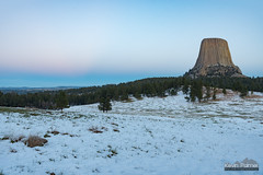 Twilight at the Tower (kevin-palmer) Tags: devilstower nationalmonument devilstowernationalmonument wyoming blackhills april spring snow snowy white cold clear blue sky evening twilight pink beltofvenus monolith tamron2470mmf28 nikond750 green grass grasslands pinetrees forest joynerridge prairie