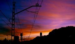 La catenaria (portalealba) Tags: cambrils tarragona cataluña españa spain sunset sol street silueta ocaso cielo nubes noche nwn portalealba pentax pentaxk50