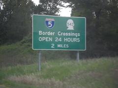 I-5 North - Border Crossing Hours (sagebrushgis) Tags: biggreensign bordercrossing internationalboundary peacearch pacifichighway sign washington blaine i5 wa543