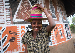 Ethiopian woman with a hat standing in front of her traditional painted house, Kembata, Alaba Kuito, Ethiopia (Eric Lafforgue) Tags: abyssinia adult africa alaba architecture art building cheerful color culture cute decorated decoration depiction eastafrica ethiopia ethnic geometric halaba hat horizontal hornofafrica house hut illustration islam kulito lookingatcamera mural muslim oneperson onewomanonly outdoors painted painting portrait poverty residential ruralscene smile smiling teenager toukoul traditional tukul village waistup woman women ethio163449 alabakuito kembata