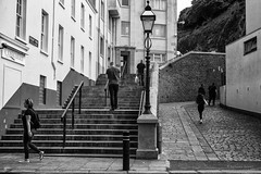 Chacun sa route, chacun son chemin... (guillaumegesret) Tags: jersey personnes people world brittany monochrome moment street streetview streetphotogrpahie streetphotographer structure streetart walk white woman weekend black blanc blackandwhite blackwhite