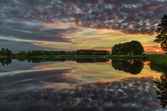The world of Elves (piotrekfil) Tags: nature landscape water waterscape sunset clouds sky lake reflections pentax poland piotrfil