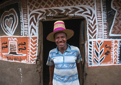 Ethiopian man with a hat standing in front of his traditional painted house, Kembata, Alaba Kuito, Ethiopia (Eric Lafforgue) Tags: abyssinia adult africa alaba architecture art artwork building cheerful color culture decorated decoration depiction eastafrica ethiopia ethnic geometric halaba horizontal hornofafrica house housing hut illustration islam kulito lookingatcamera man mural muslim onemanonly oneperson outdoors painted painting portrait poverty residential ruralscene smile smiling toukoul traditional tukul village waistup ethio1634511 alabakuito kembata