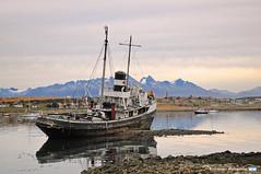 San Christopher (YellowSingle 单黄) Tags: ushuaia patagonia wreck boat land fire nikon harbor legend marine ocean